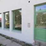 Fa bejárati ajtó RAL zöld ipari felületkezeléssel.